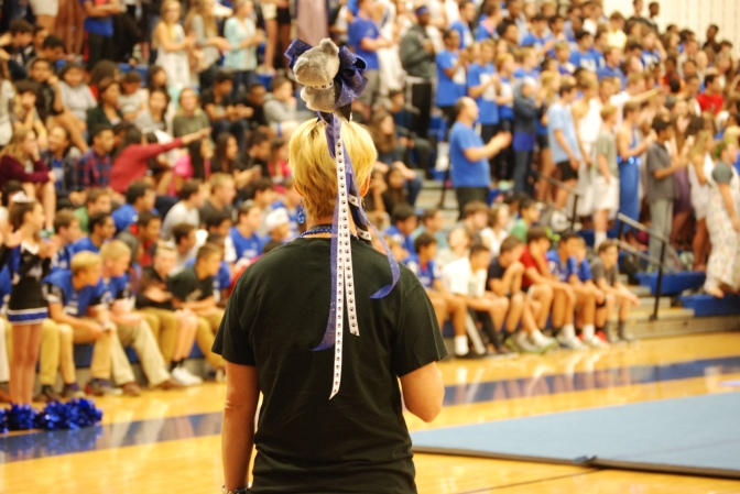 "The Scepter of School Spirit- Ms. Sommer Crawford holds the school spirit stick that would be awarded to the class with the most school spirit. The winner was based on spirit week that students dressed up for and the hallways that were decorated the night before the pep rally. ""I feel like we're finally getting more school spirit. Students know what they're suppose to look like and get excited for them,"" said Crawford. Photo by: Sara Koochagian"